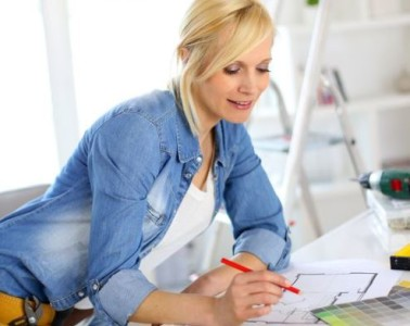woman drawing up plans to improve house